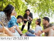 Купить «friends with drinks and food at picnic in park», фото № 29523981, снято 17 июня 2018 г. (c) Syda Productions / Фотобанк Лори