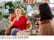 Купить «female friends drinking coffee and talking at cafe», фото № 29524041, снято 7 августа 2018 г. (c) Syda Productions / Фотобанк Лори