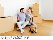 Купить «happy couple with boxes and dog moving to new home», фото № 29524149, снято 4 июня 2017 г. (c) Syda Productions / Фотобанк Лори