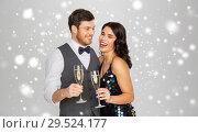 Купить «happy couple with champagne celebrating christmas», фото № 29524177, снято 15 декабря 2017 г. (c) Syda Productions / Фотобанк Лори