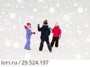 Купить «happy little kids playing outdoors in winter», фото № 29524197, снято 10 февраля 2018 г. (c) Syda Productions / Фотобанк Лори