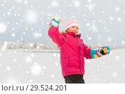 Купить «happy girl playing and throwing snowball in winter», фото № 29524201, снято 10 февраля 2018 г. (c) Syda Productions / Фотобанк Лори