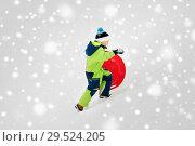 Купить «happy boy with snow saucer sled in winter», фото № 29524205, снято 10 февраля 2018 г. (c) Syda Productions / Фотобанк Лори