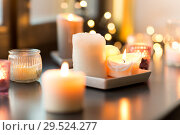 Купить «candles burning on window sill with garland lights», фото № 29524277, снято 13 января 2018 г. (c) Syda Productions / Фотобанк Лори