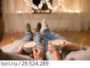 Купить «close up of couple drinking hot chocolate at home», фото № 29524289, снято 13 января 2018 г. (c) Syda Productions / Фотобанк Лори