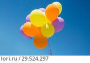 Купить «close up of colorful helium balloons in blue sky», фото № 29524297, снято 29 мая 2018 г. (c) Syda Productions / Фотобанк Лори