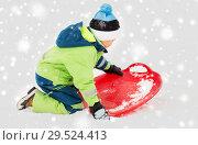 Купить «happy boy with snow saucer sled in winter», фото № 29524413, снято 10 февраля 2018 г. (c) Syda Productions / Фотобанк Лори