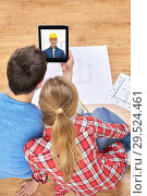 Купить «couple having video call with builder», фото № 29524461, снято 26 января 2014 г. (c) Syda Productions / Фотобанк Лори