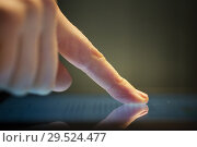 Купить «close up of hand using computer touch screen», фото № 29524477, снято 3 января 2018 г. (c) Syda Productions / Фотобанк Лори