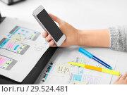 Купить «web designer working on smartphone user interface», фото № 29524481, снято 17 января 2018 г. (c) Syda Productions / Фотобанк Лори