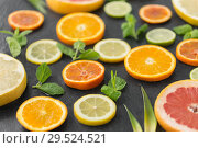 Купить «close up of grapefruit, orange, pomelo and lime», фото № 29524521, снято 4 апреля 2018 г. (c) Syda Productions / Фотобанк Лори