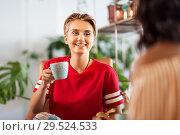 Купить «female friends drinking coffee and talking at cafe», фото № 29524533, снято 7 августа 2018 г. (c) Syda Productions / Фотобанк Лори