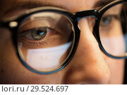 Купить «close up of woman in glasses looking at screen», фото № 29524697, снято 3 января 2018 г. (c) Syda Productions / Фотобанк Лори