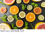 Купить «close up of different citrus fruit slices», фото № 29524721, снято 4 апреля 2018 г. (c) Syda Productions / Фотобанк Лори