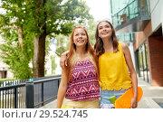 Купить «teenage girls with short skateboards in city», фото № 29524745, снято 19 июля 2018 г. (c) Syda Productions / Фотобанк Лори