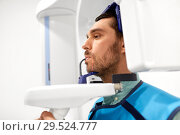 Купить «patient having x-ray scanning at dental clinic», фото № 29524777, снято 22 апреля 2018 г. (c) Syda Productions / Фотобанк Лори