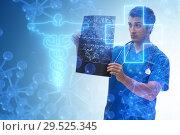 Купить «Doctor looking at x-ray image in telehealth concept», фото № 29525345, снято 26 марта 2019 г. (c) Elnur / Фотобанк Лори