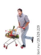 Купить «Young man with supermarket cart trolley on white», фото № 29529229, снято 2 августа 2018 г. (c) Elnur / Фотобанк Лори
