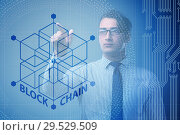 Купить «Young businessman in innovative blockchain concept», фото № 29529509, снято 21 июня 2019 г. (c) Elnur / Фотобанк Лори