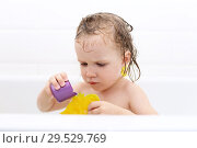 Cute little girl taking bath and playing toys. Стоковое фото, фотограф ivolodina / Фотобанк Лори