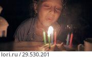 Купить «Boy blowing out his birthday candles», видеоролик № 29530201, снято 10 декабря 2018 г. (c) Данил Руденко / Фотобанк Лори