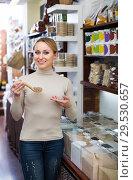 Купить «Blond woman choosing cereals», фото № 29530657, снято 19 апреля 2019 г. (c) Яков Филимонов / Фотобанк Лори