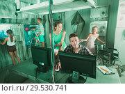 Купить «Young family is passing of quest room», фото № 29530741, снято 3 августа 2017 г. (c) Яков Филимонов / Фотобанк Лори