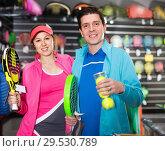 Купить «Sporty couple in sportwear is demonstraiting modern racket and balls for padel», фото № 29530789, снято 7 февраля 2018 г. (c) Яков Филимонов / Фотобанк Лори