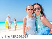 Купить «Portrait of happy family on the beach», фото № 29536689, снято 9 апреля 2017 г. (c) Дмитрий Травников / Фотобанк Лори