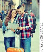 Купить «Couple with luggage walking», фото № 29537125, снято 27 мая 2019 г. (c) Яков Филимонов / Фотобанк Лори