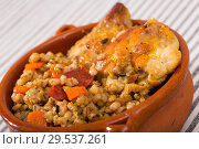 Купить «Barley porridge with chicken thighs in ceramic bowl», фото № 29537261, снято 2 июля 2018 г. (c) Яков Филимонов / Фотобанк Лори