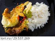 Купить «Breaded cabbage with sauces and rice on black dish», фото № 29537269, снято 19 января 2019 г. (c) Яков Филимонов / Фотобанк Лори