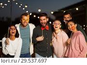 Купить «happy friends with party props at rooftop», фото № 29537697, снято 2 сентября 2018 г. (c) Syda Productions / Фотобанк Лори