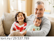 Купить «happy father with preteen and baby son at home», фото № 29537789, снято 14 апреля 2018 г. (c) Syda Productions / Фотобанк Лори