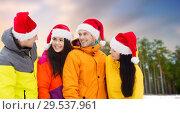 Купить «friends in santa hats and ski suits on christmas», фото № 29537961, снято 7 февраля 2015 г. (c) Syda Productions / Фотобанк Лори