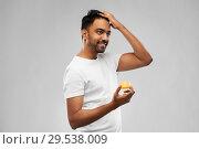 Купить «indian man applying hair wax or styling gel», фото № 29538009, снято 27 октября 2018 г. (c) Syda Productions / Фотобанк Лори