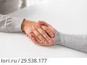 Купить «close up of young woman holding senior man hands», фото № 29538177, снято 7 июля 2016 г. (c) Syda Productions / Фотобанк Лори