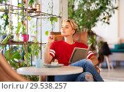 Купить «teenage girl with notebook at coffee shop or cafe», фото № 29538257, снято 7 августа 2018 г. (c) Syda Productions / Фотобанк Лори