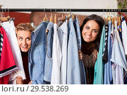 Купить «women having fun at vintage clothing store hanger», фото № 29538269, снято 7 августа 2018 г. (c) Syda Productions / Фотобанк Лори