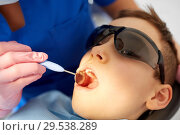 Купить «boy having teeth checkup at dental clinic», фото № 29538289, снято 22 апреля 2018 г. (c) Syda Productions / Фотобанк Лори