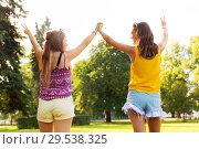 Купить «teenage girls showing peace hand sign at park», фото № 29538325, снято 19 июля 2018 г. (c) Syda Productions / Фотобанк Лори