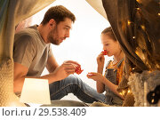 Купить «family playing tea party in kids tent at home», фото № 29538409, снято 27 января 2018 г. (c) Syda Productions / Фотобанк Лори
