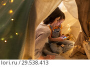 Купить «happy family with smartphone in kids tent at home», фото № 29538413, снято 27 января 2018 г. (c) Syda Productions / Фотобанк Лори