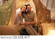 Купить «happy couple in kids tent at home», фото № 29538417, снято 27 января 2018 г. (c) Syda Productions / Фотобанк Лори