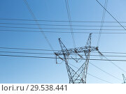 Купить «transmission tower and power line over blue sky», фото № 29538441, снято 3 марта 2018 г. (c) Syda Productions / Фотобанк Лори