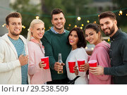 Купить «friends with drinks in party cups at rooftop», фото № 29538509, снято 2 сентября 2018 г. (c) Syda Productions / Фотобанк Лори
