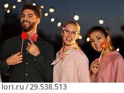 Купить «happy friends with party props at rooftop», фото № 29538513, снято 2 сентября 2018 г. (c) Syda Productions / Фотобанк Лори