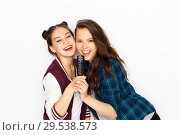 Купить «teenage girls singing to hairbrush and having fun», фото № 29538573, снято 19 декабря 2015 г. (c) Syda Productions / Фотобанк Лори