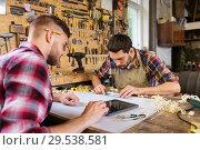 Купить «carpenters with tablet and blueprint at workshop», фото № 29538581, снято 14 мая 2016 г. (c) Syda Productions / Фотобанк Лори