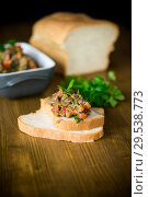 Купить «eggplant caviar with tomatoes and a slice of bread», фото № 29538773, снято 21 ноября 2018 г. (c) Peredniankina / Фотобанк Лори